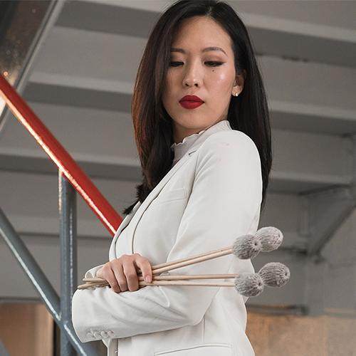Woman with tympany sticks