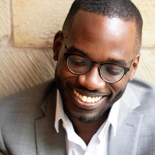 Smiling man wearing glasses and suit