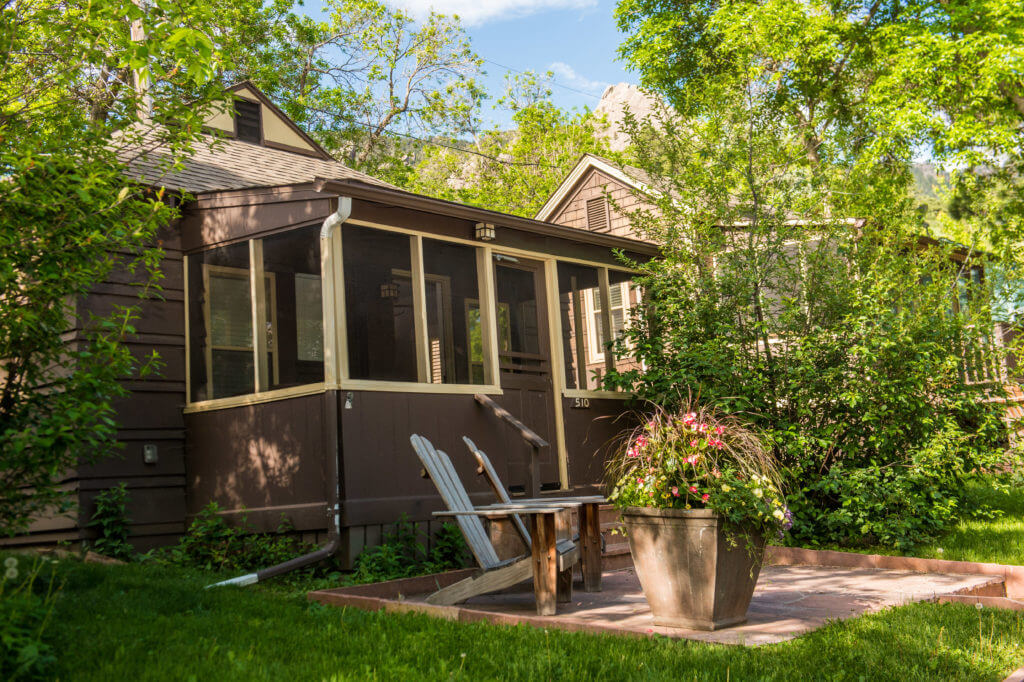 Private Chautauqua cottage with plant pot and Flatirons mountains behind
