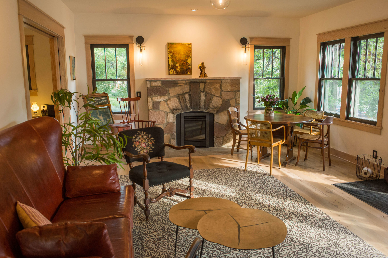 historic furniture in remodeled cottage