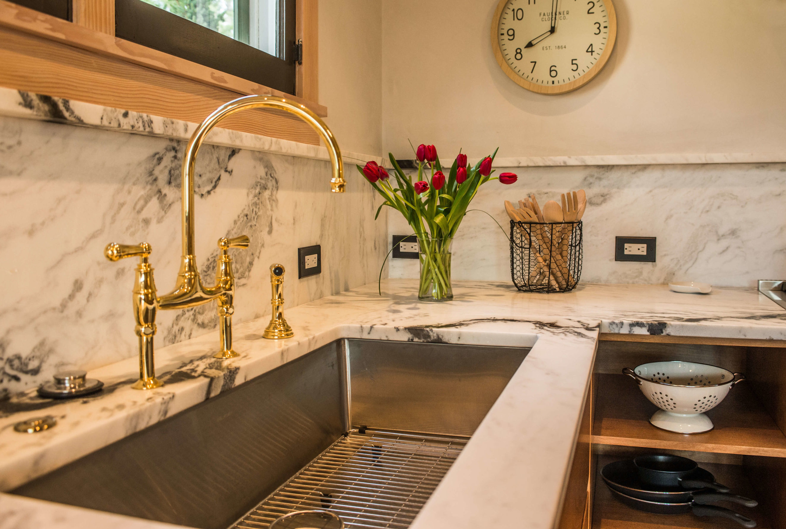 clock, tulips and gold faucet