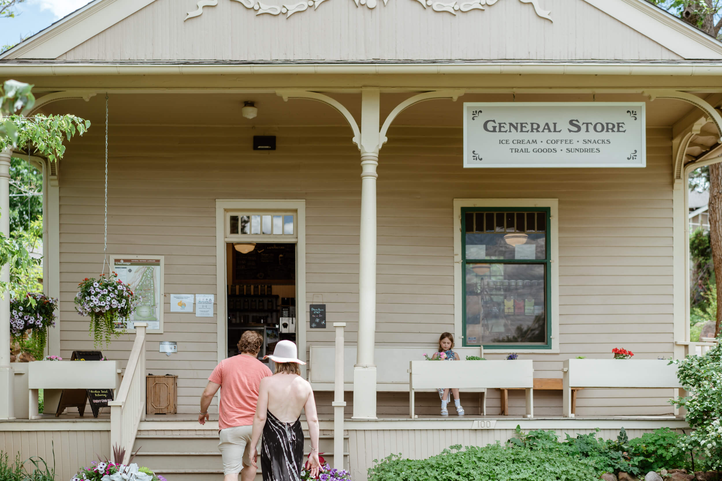 couple enter general store in summer